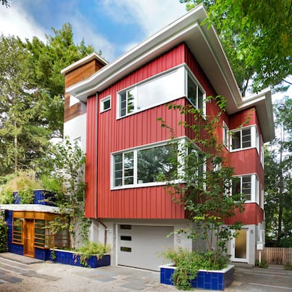 LEED-Awarded reclaimed rebuild with Douglas Fir tank siding - Wolf Architects